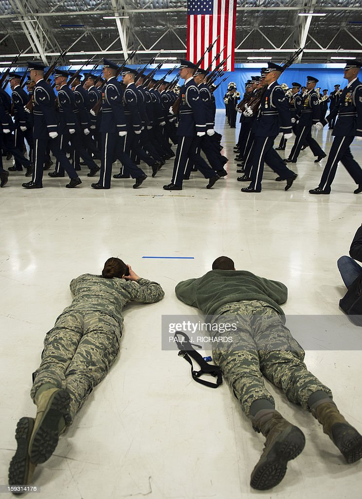 Military photographers get a low angle during a US Air Force Band and Honor Guard rehearsal for the upcoming 57th Inaugural Parade for US President Barack Obama inside a large aircraft hangar January 11, 2013, at Joint Base Andrews, in Maryland. The 57th Inaugural Parade will be on January 21, 2013 in Washington, DC. Photo/Paul J. Richards