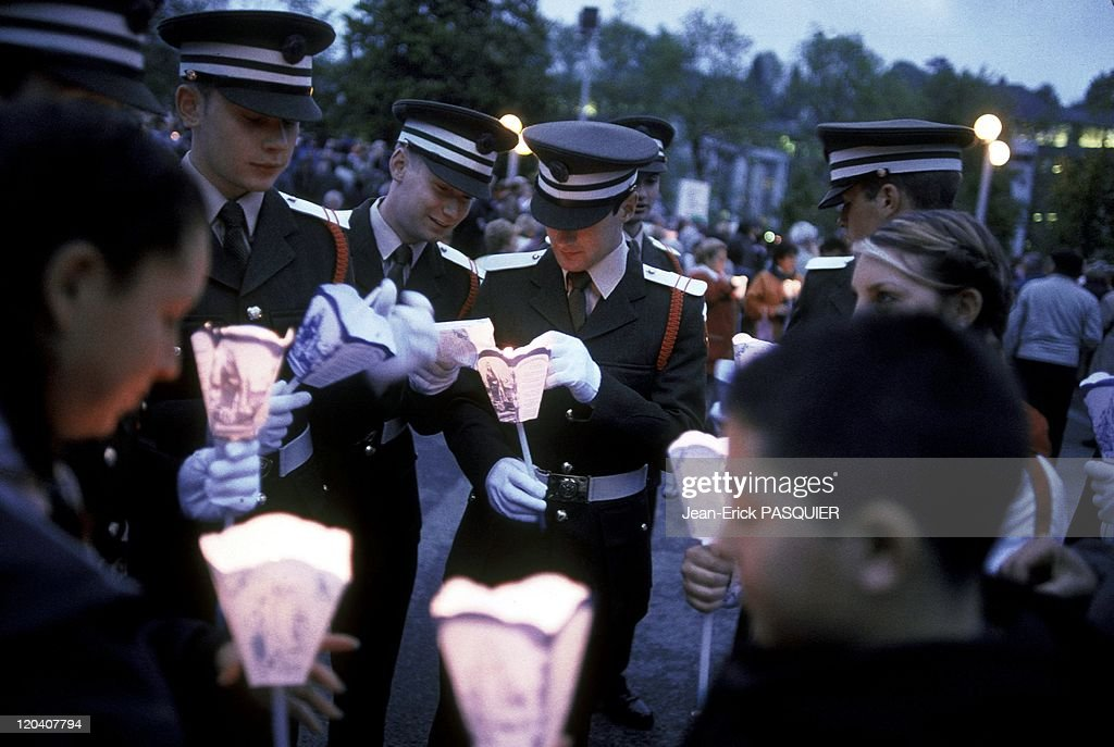Military Pilgrimage In Lourdes France On May 14 2004 Irish soldiers during the torchlightThe military pilgrimage to Soldiers of 36 nations over the...