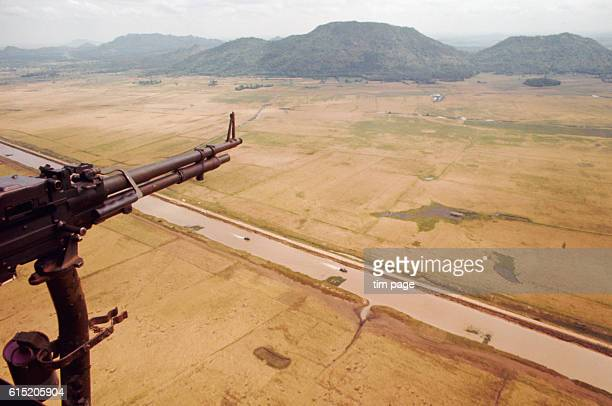 A military plane passes over a barren river plain at the VietnameseCambodian border Vietnam 1969 | Location CamodiaVietnam border