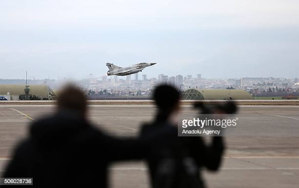 A military plane take off as Turkish Defense Minister Ismet Yilmaz and German Defence Minister Ursula Von Der Leyen hold a press conference at...