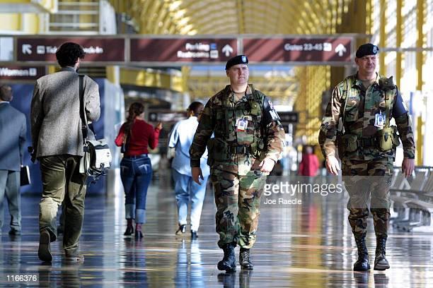 Military Poice from the 229th National Guard Co of Virginia Beach patrol the Ronald Reagan Washington National Airport October 4 2001 in Arlington VA...