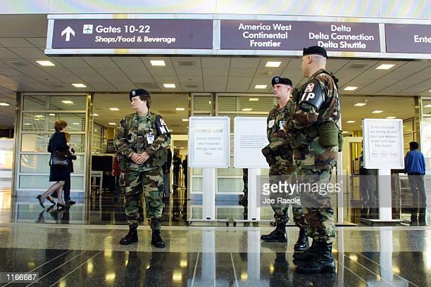 Military Poice from the 229th National Guard Unit of Virginia Beach patrol the Ronald Reagan Washington National Airport October 4 2001 in Arlington...