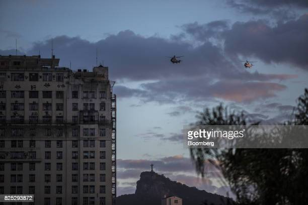 Military police helicopters fly over the Christ the Redeemer statue in Rio de Janeiro Brazil on Sunday July 30 2017 Thousands of military soldiers...