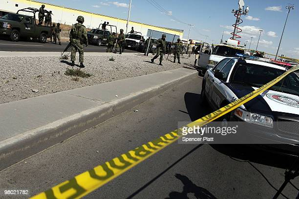 Military police keep guard at the site of a murder on March 24 2010 in Juarez Mexico Secretary of State Hillary Rodham Clinton Defense Secretary...
