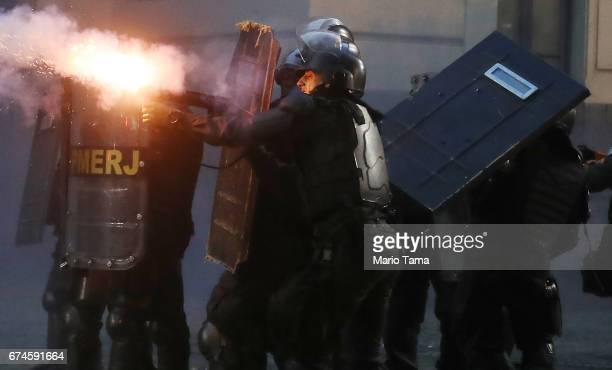 Military Police officer fires tear gas towards protestors during a nationwide general strike on April 28 2017 in Rio de Janeiro Brazil The general...