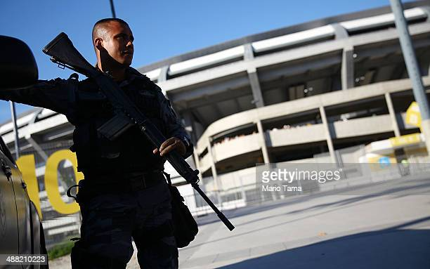 A military police officer keeps watch before a match between Flamengo and Palmeiras as part of Brasileirao Series A 2014 at Maracana Stadium on May...