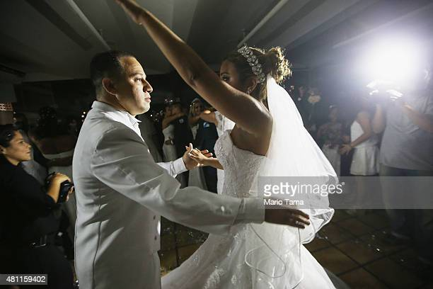 Military police officer Luciana dances with her new husband Alan at a communal wedding ceremony for officers who patrol some of Rio's favelas on July...