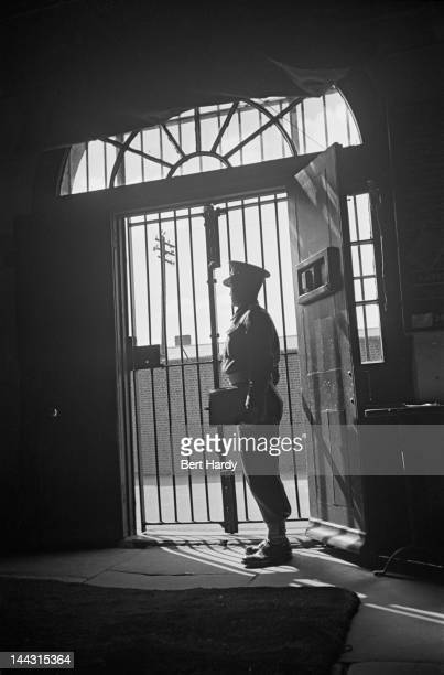 A military police officer stands guard at the entrance to the Military Detention Barracks in Aldershot Hampshire May 1942 The establishment derived...