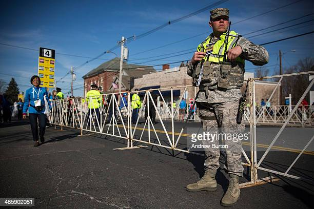 Military Police officer stands guard prior to the start of the Boston Marathon on April 21 2014 in Hopkington Massachusetts Today marks the 118th...