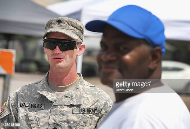 A military police officer with the Missouri Army National Guard stands guard at the police command center which was established to direct security...