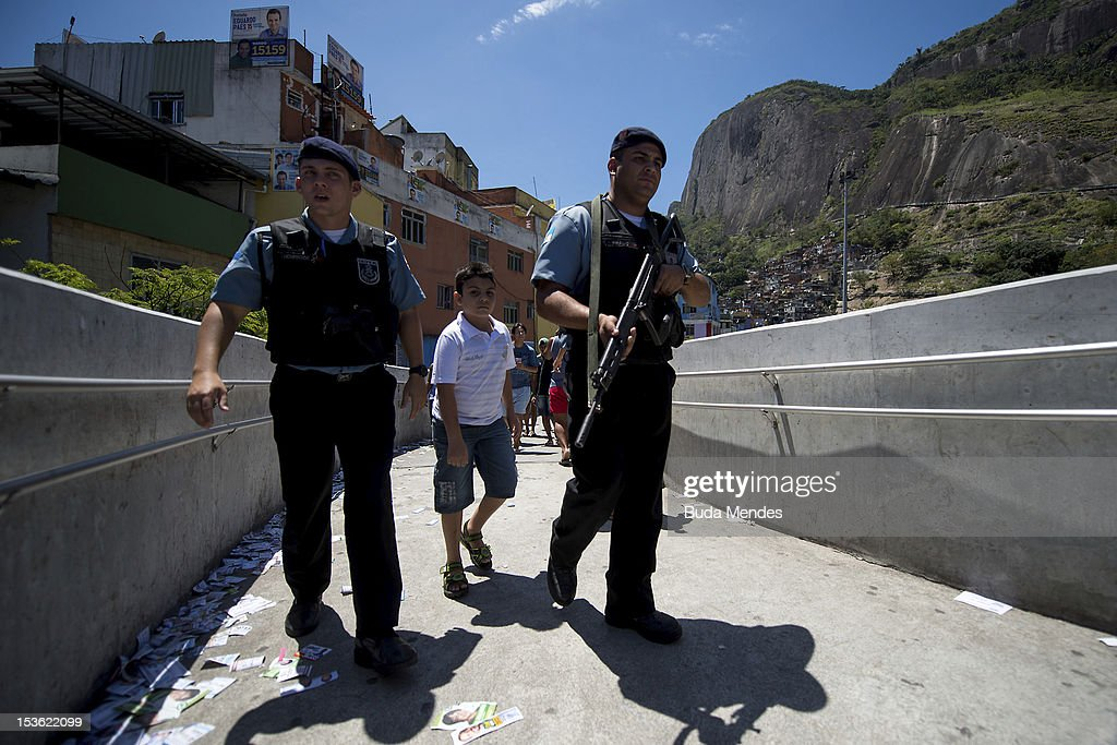 Military police officers patrol the polling station at Rocinha shanty town on October 07, 2012 in Rio de Janeiro, Brazil.
