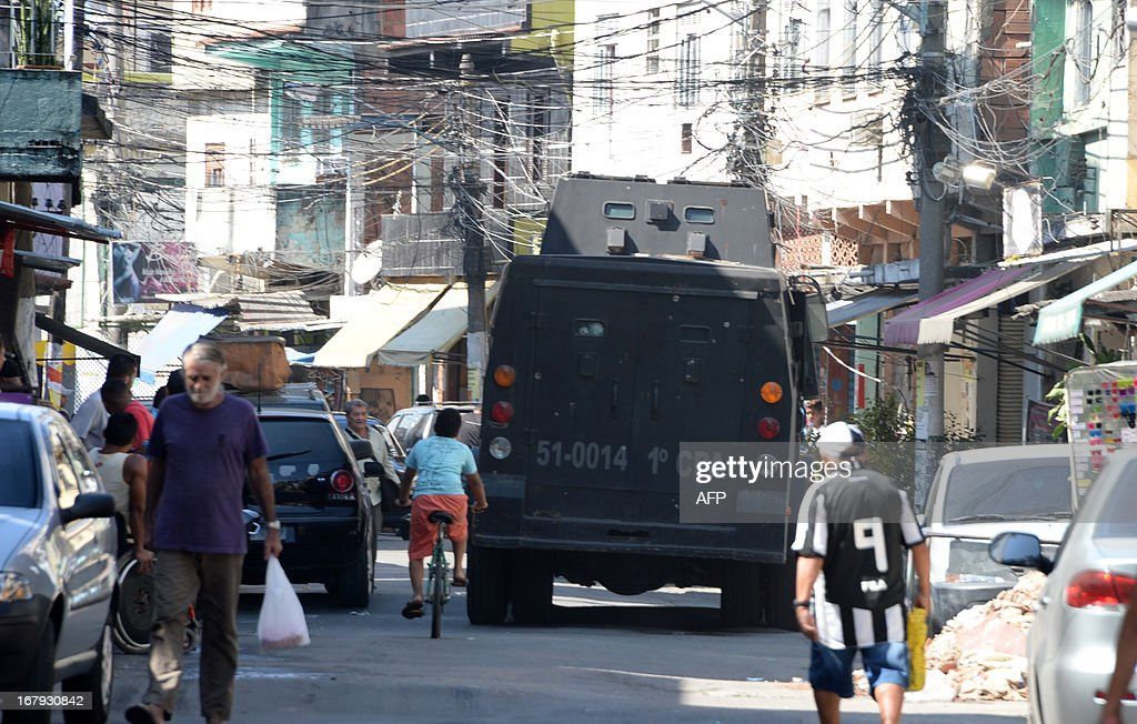 A Military Police riot vehicle patrol streets during operation against drug dealers at Mare del Rio shantytown in Rio de Janeiro on May 2, 2013. The operation is part of a government strategy designed to combat crime and reassert full control of the Rio de Janeiro metropolis ahead of the upcoming FIFA Confederations Cup, the football World Cup of 2014 and the Olympic Games two years later.