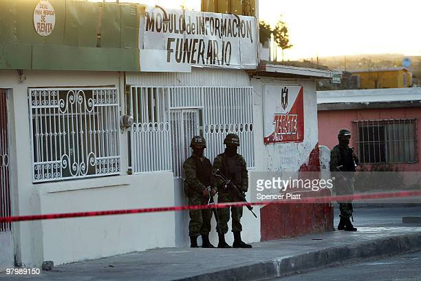 Military police stand guard at the scene of a murder of four people at a funeral home on March 23 2010 in Juarez Mexico Secretary of State Hillary...