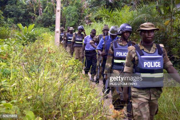 Military police walk through the bush in search of arms and criminals at Omadino community in Warri South district of the Niger Delta 04 June 2004...