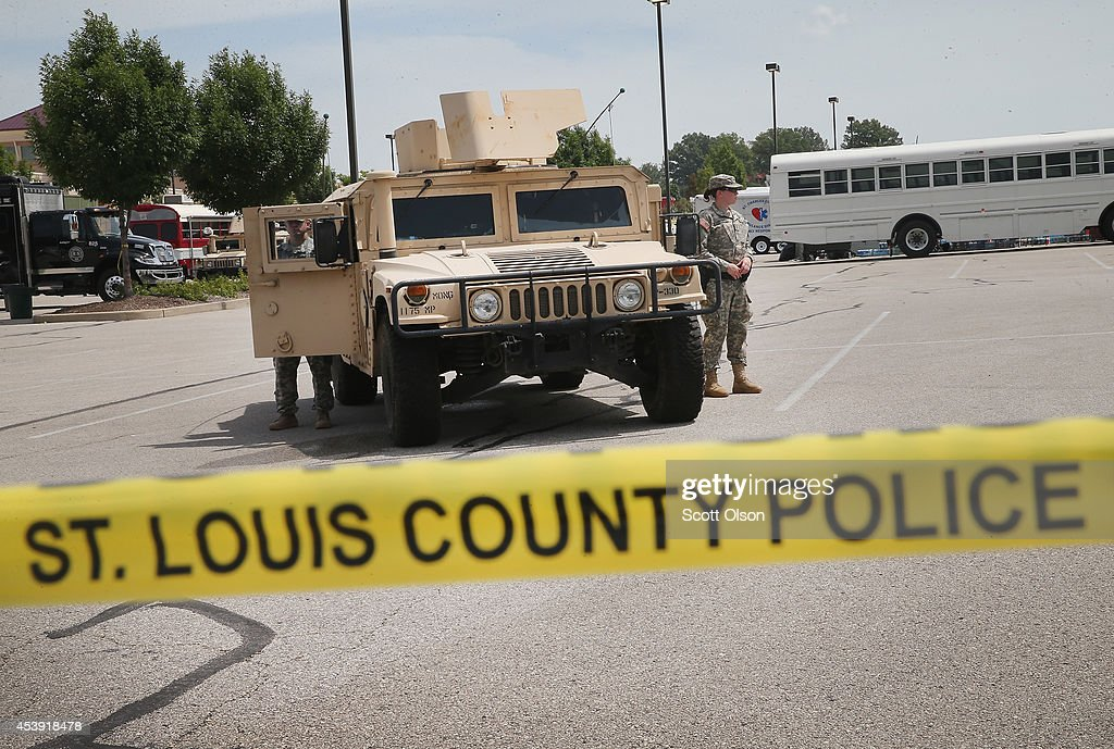 Military police with the Missouri Army National Guard stand guard at the police command center which was established to direct security operations following unrest after the recent death of Michael Brown on August 21, 2014 in Ferguson, Missouri. Brown was shot and killed by a Ferguson police officer on August 9. Missouri Gov. Jay Nixon ordered the withdrawal of the National Guard four days after they were deployed to help during the protests following the shooting death of Michael Brown.