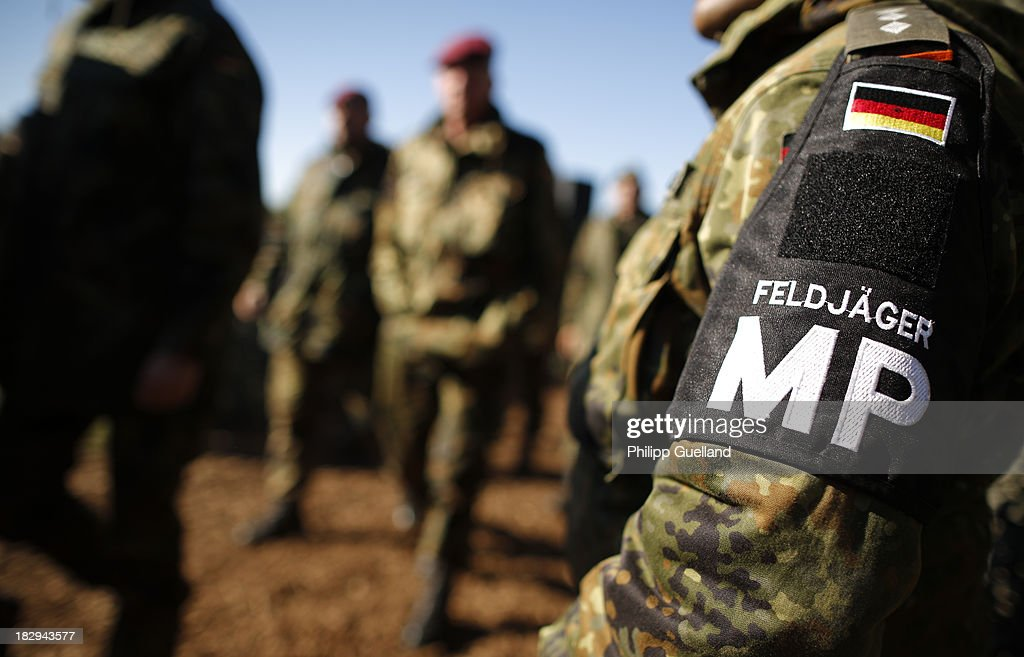 A military policeman (Feldjaeger) of the Bundeswehr is seen during the annual military exercises held for the media at the Bergen military training grounds on October 2, 2013 near Munster, Germany. The Bundeswehr is transitioning to a professional army as Germany recently ended mandatory military service.