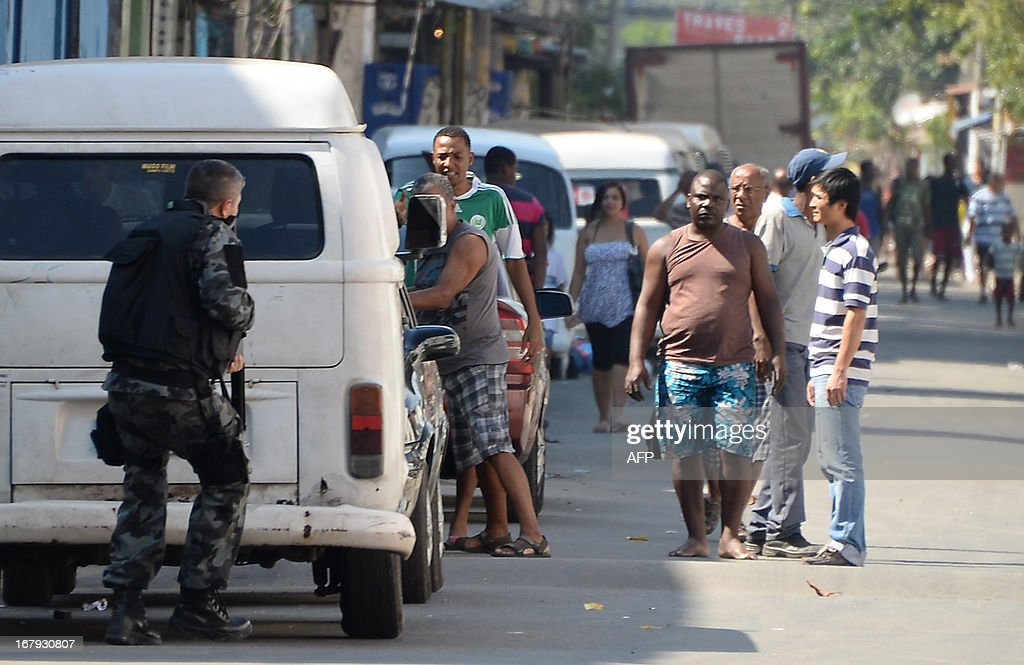 Military policemen carry out an operation against drug dealers at Mare del Rio shantytown in Rio de Janeiro on May 2, 2013. The operation is part of a government strategy designed to combat crime and reassert full control of the Rio de Janeiro metropolis ahead of the upcoming FIFA Confederations Cup, the football World Cup of 2014 and the Olympic Games two years later.