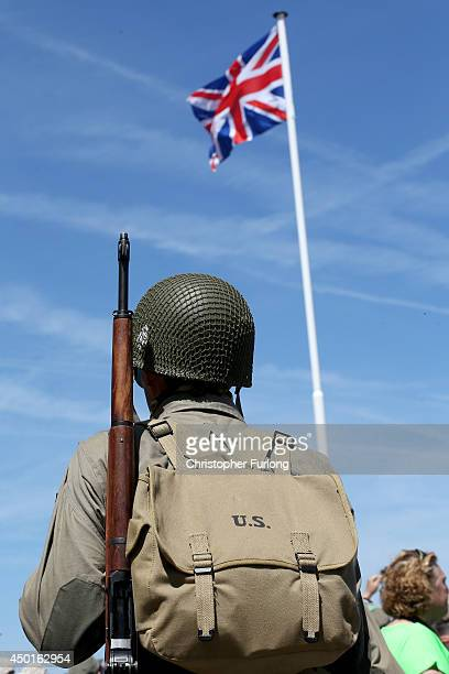 A military reenactor watches events on Gold Beach at Arromanche to commemorate the 70th anniversary of the DDay landings on June 6 2014 in...