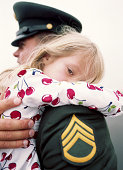 Military Sargent holding crying daughter (5-7)