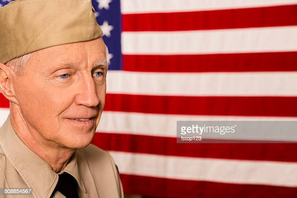 Military: Senior veteran in uniform with American flag.