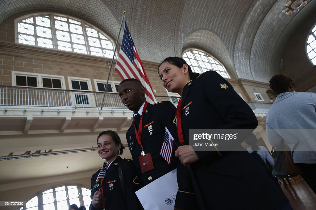 U.S. military service members pose for photos after receiving their U.S. citizenship at a naturalization ceremony on Ellis Island on May 27, 2016 in New York City. U.S. Secretary of Homeland Security Jeh Johnson administered the oath of citizenship to immigrants from 39 countries on the historic island in New York Harbor where millions of immigrants first arrived to America. The ceremony, held by U.S. Citizenship and Immigration Services (USCIS), was held in honor of Memorial Day and is one of 100 naturalization ceremonies held in U.S. national parks in celebration of the National Park Service's 100th anniversary.