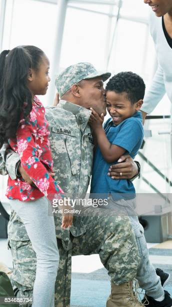 US Military Soldier kissing his children