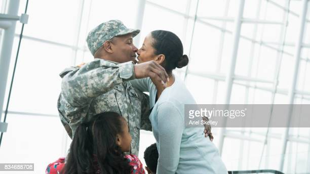 US Military Soldier returning home kissing his wife