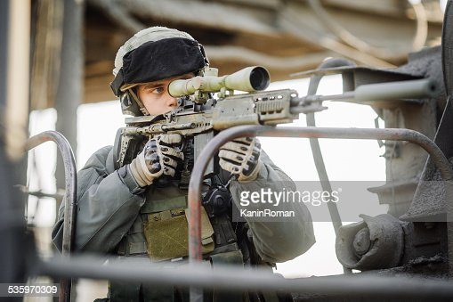 military soldier shooting an sniper rifle : Stock Photo