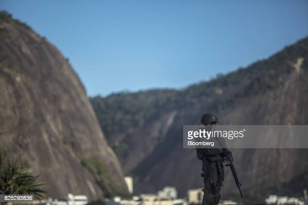 A military soldier stands guard in Rio de Janeiro Brazil on Saturday July 29 2017 Thousands of military soldiers had been activated in Rio de Janeiro...