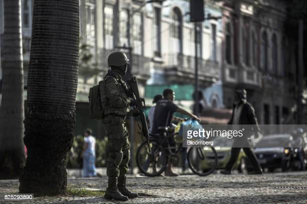 A military soldier stands guard in Rio de Janeiro Brazil on Sunday July 30 2017 Thousands of military soldiers had been activated in Rio de Janeiro...