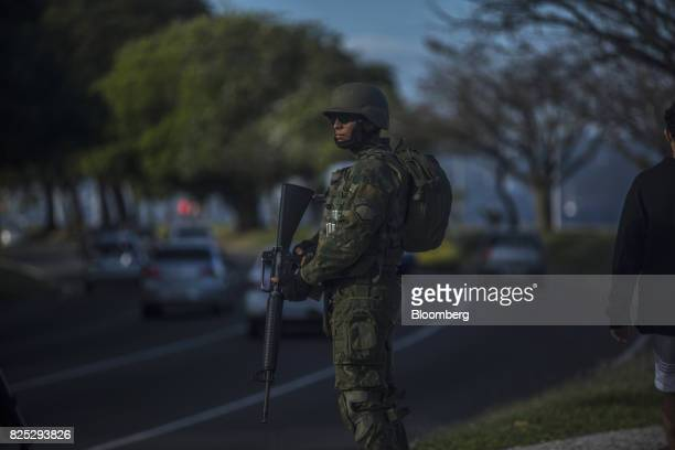 A military soldier stands guard near a road in Rio de Janeiro Brazil on Saturday July 29 2017 Thousands of military soldiers had been activated in...