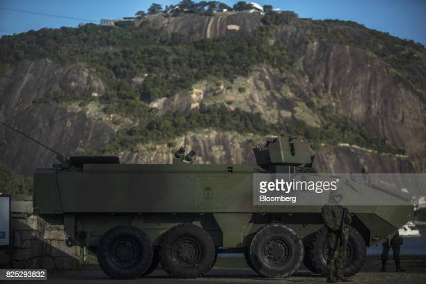 A military soldier stands guard next to an armored vehicle in Rio de Janeiro Brazil on Saturday July 29 2017 Thousands of military soldiers had been...