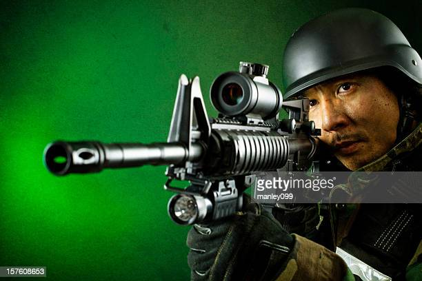 military soldier with aimed rifle