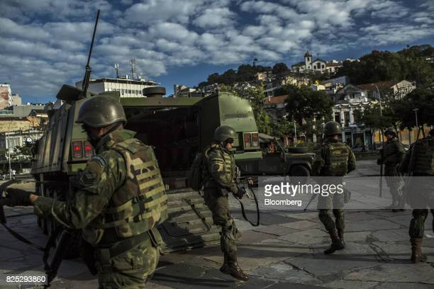 Military soldiers exit an armored vehicle in the Bohemian Lapa neighborhood of Rio de Janeiro Brazil on Sunday July 30 2017 Thousands of military...