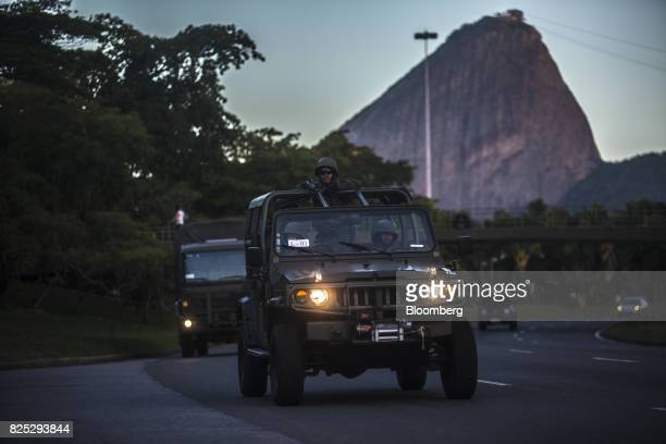 Military soldiers in a vehicle patrol the streets in Rio de Janeiro Brazil on Saturday July 29 2017 Thousands of military soldiers had been activated...