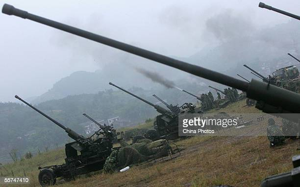Military soldiers of Chongqing reserve force launch the antiaircraft artilleries during a military drill on September 23 2005 in Chongqing...