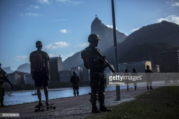 Military soldiers patrol a street in Rio de Janeiro Brazil on Saturday July 29 2017 Thousands of military soldiers had been activated in Rio de...
