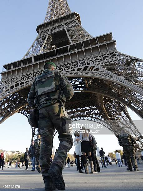 Military soldiers patrol in front of the Eiffel Tower in Paris on November 15 during a state of emergency declared following terrorist attacks in the...