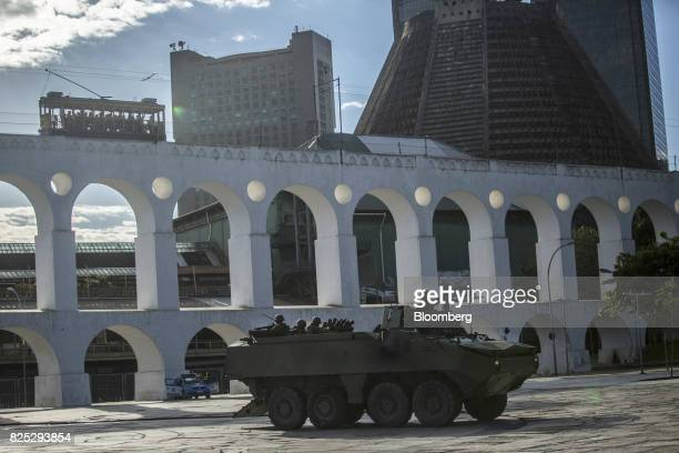 Military soldiers patrol on an armored vehicle in the Bohemian Lapa neighborhood of Rio de Janeiro Brazil on Sunday July 30 2017 Thousands of...