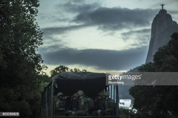 Military soldiers sit in a truck while patrolling a street in Rio de Janeiro Brazil on Saturday July 29 2017 Thousands of military soldiers had been...