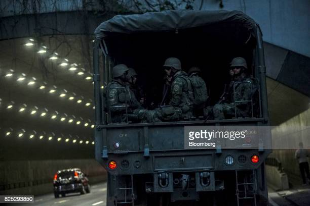 Military soldiers sit in a truck while patrolling the streets in Rio de Janeiro Brazil on Saturday July 29 2017 Thousands of military soldiers had...