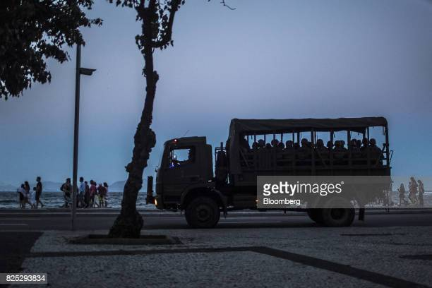 Military soldiers sit in a truck while patrolling the streets near Copacabana beach in Rio de Janeiro Brazil on Saturday July 29 2017 Thousands of...