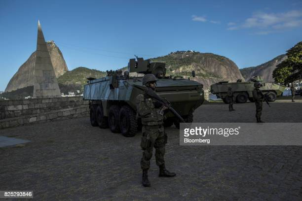 Military soldiers stand guard in Rio de Janeiro Brazil on Saturday July 29 2017 Thousands of military soldiers had been activated in Rio de Janeiro...
