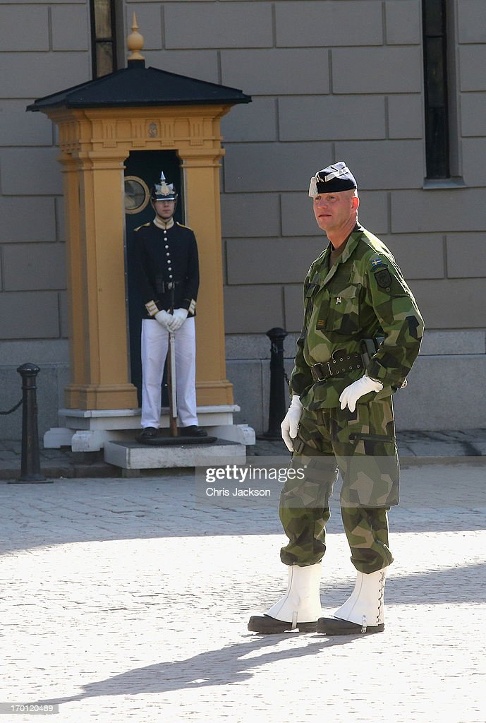 Military stand guard over the Royal Palace as preparations for the wedding of Princess Madeleine of Sweden and Christopher O'Neill continues on June 7, 2013 in Stockholm, Sweden.
