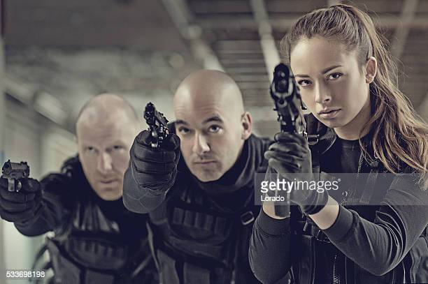 Military swat team members during operation in abandoned warehouse