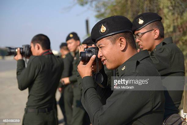 Military take pictures as Thailand's military forces mark the 2014 Thai Armed Forces day with a military parade at the 2nd Cavalry Division Kings...