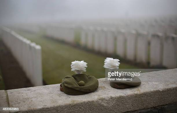 Military Tam O Shanter caps belonging to soldiers of The 2nd Battalion The Royal Regiment of Scotland are placed on the wall of Loos British Cemetery...