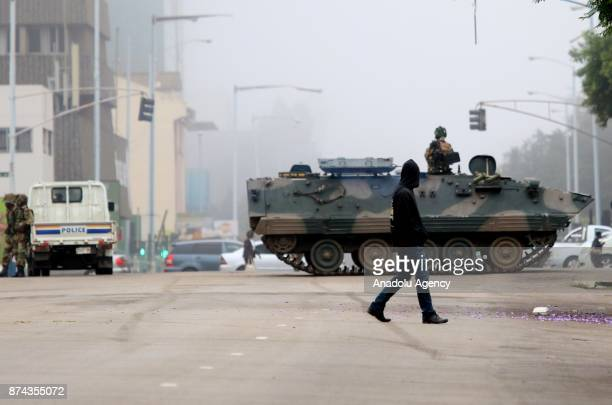 A military tank seals off a main road to the presidential office within the military activities taking place in Harare Zimbabwe on November 15 2017