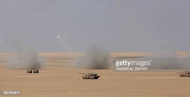 A military tank takes part in a military exercise at Udaira military range 140 km North of Kuwait City on February 26 as part of joint GCC military...