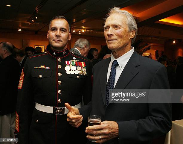Military Technical Advisor Sgt Major James Dever USMC and actor/director Clint Eastwood pose at the afterparty for the premiere of Paramount's 'Flags...